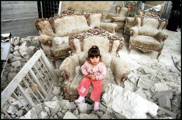 Jumana, a Palestinian child, in the rubble that was once her home in Jabal Mukab