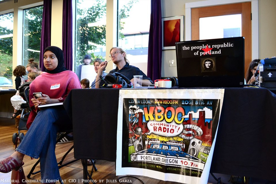 Saba Ahmed at KBOO table