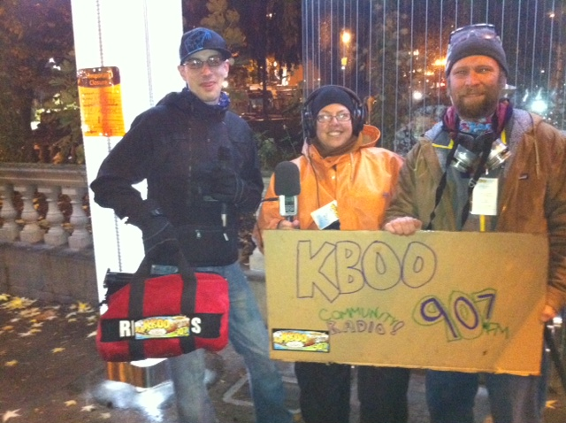 KBOO goes mobile at Occupy Portland eviction (laptop in red bag)