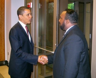 President Obama and John Boyd Jr. of the National Black Farmers Association.