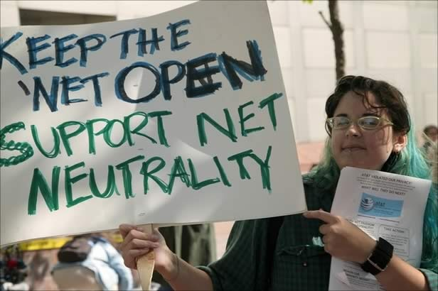 protestor with sign calling for net neutrality